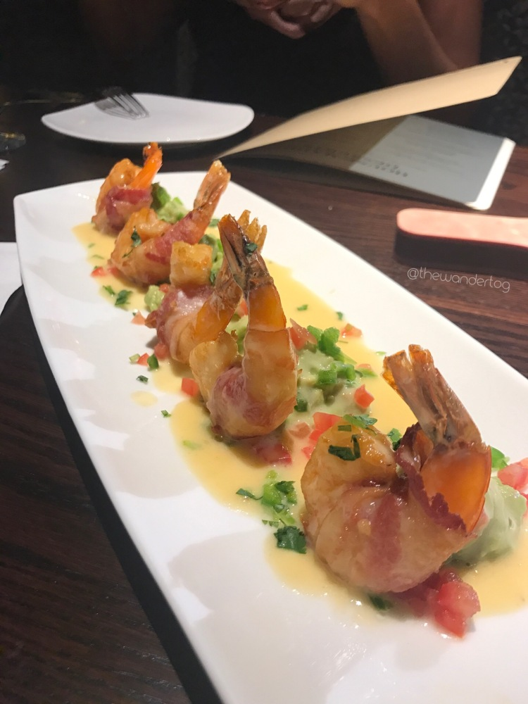 Mexican Drunken Shrimp: bacon-wrapped shrimp, tequila lime butter sauce, and fresh guacamole