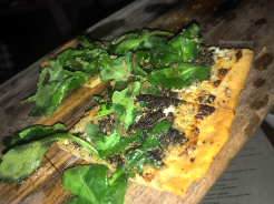 Truffle Flatbread with mascarpone, shaved truffle, and arugula